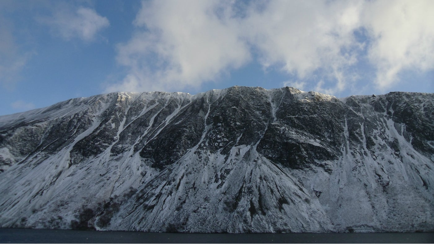 Snow settles on the screes of Illgill Head, tumbling down into Wastwater