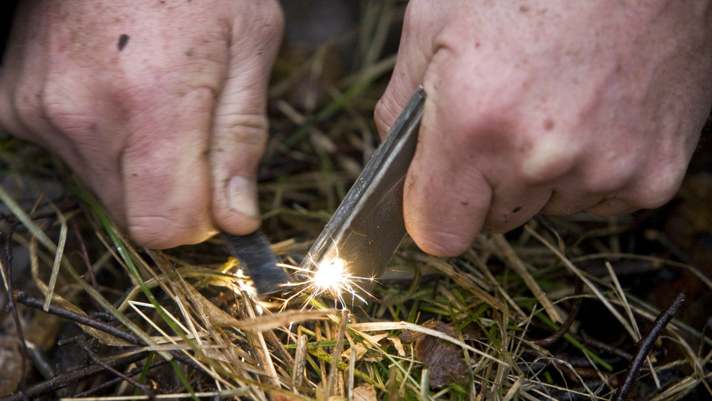Using a fire steel to make sparks