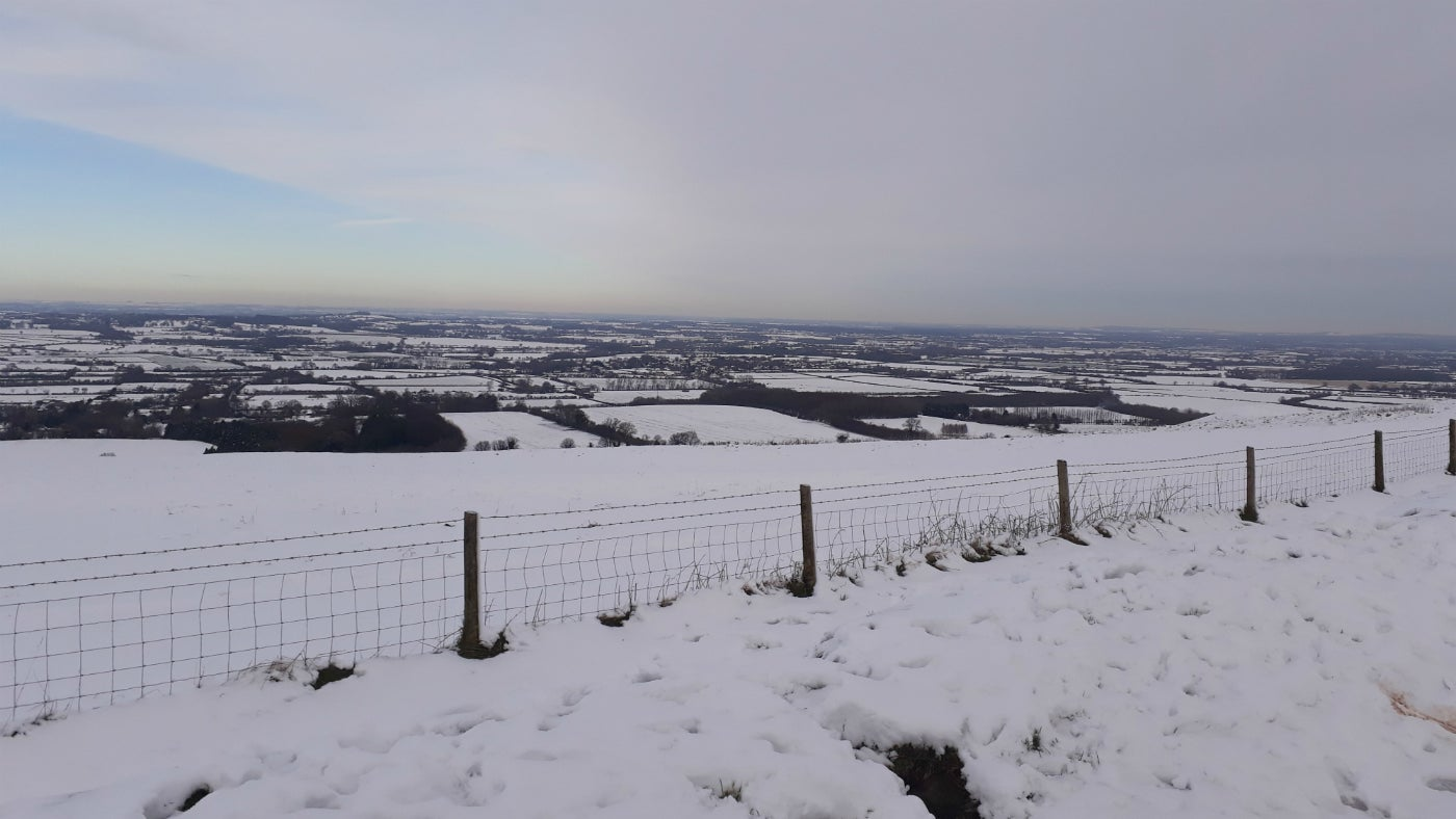 A view across the snowy hillside at White Horse Hill