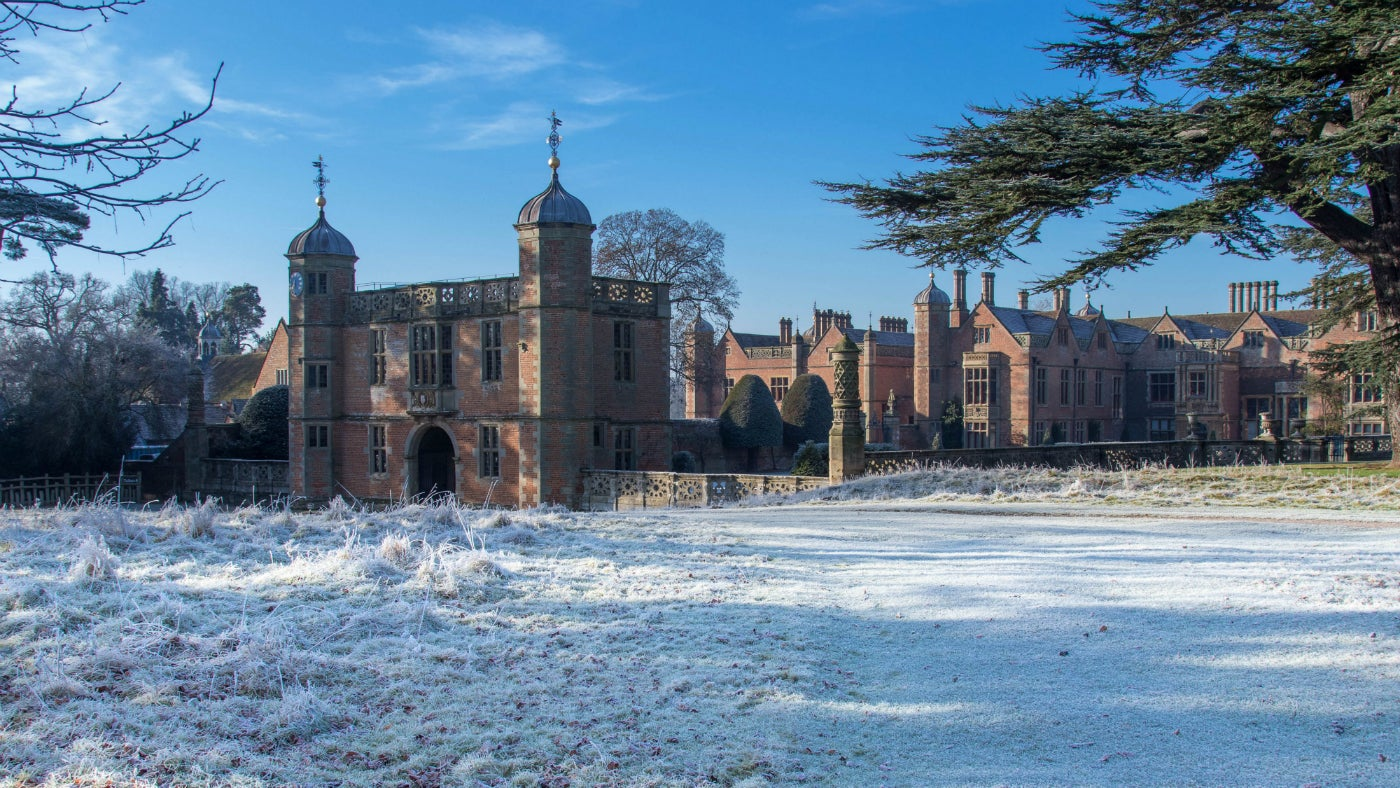 Enjoy stunning views of the house and gatehouse at Charlecote from a winter walk in the parkland