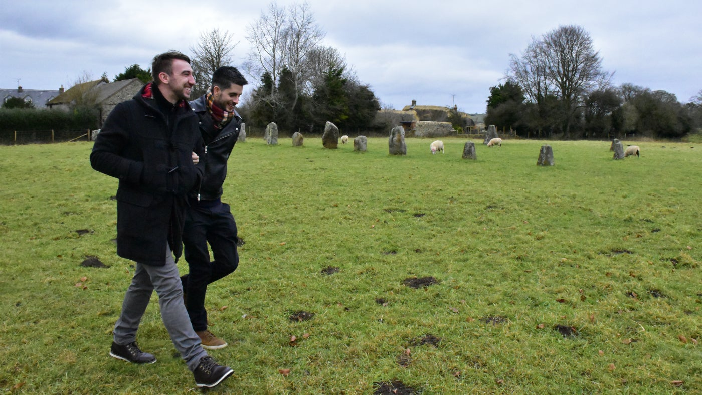 Two men walking in the stone circle
