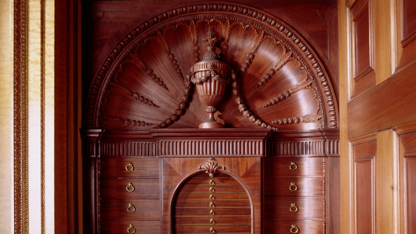 The mahogany built-in library and medal cabinet made
