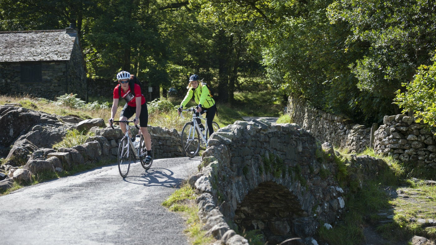 Cyclists crossing Ashness Bridge, Lake District