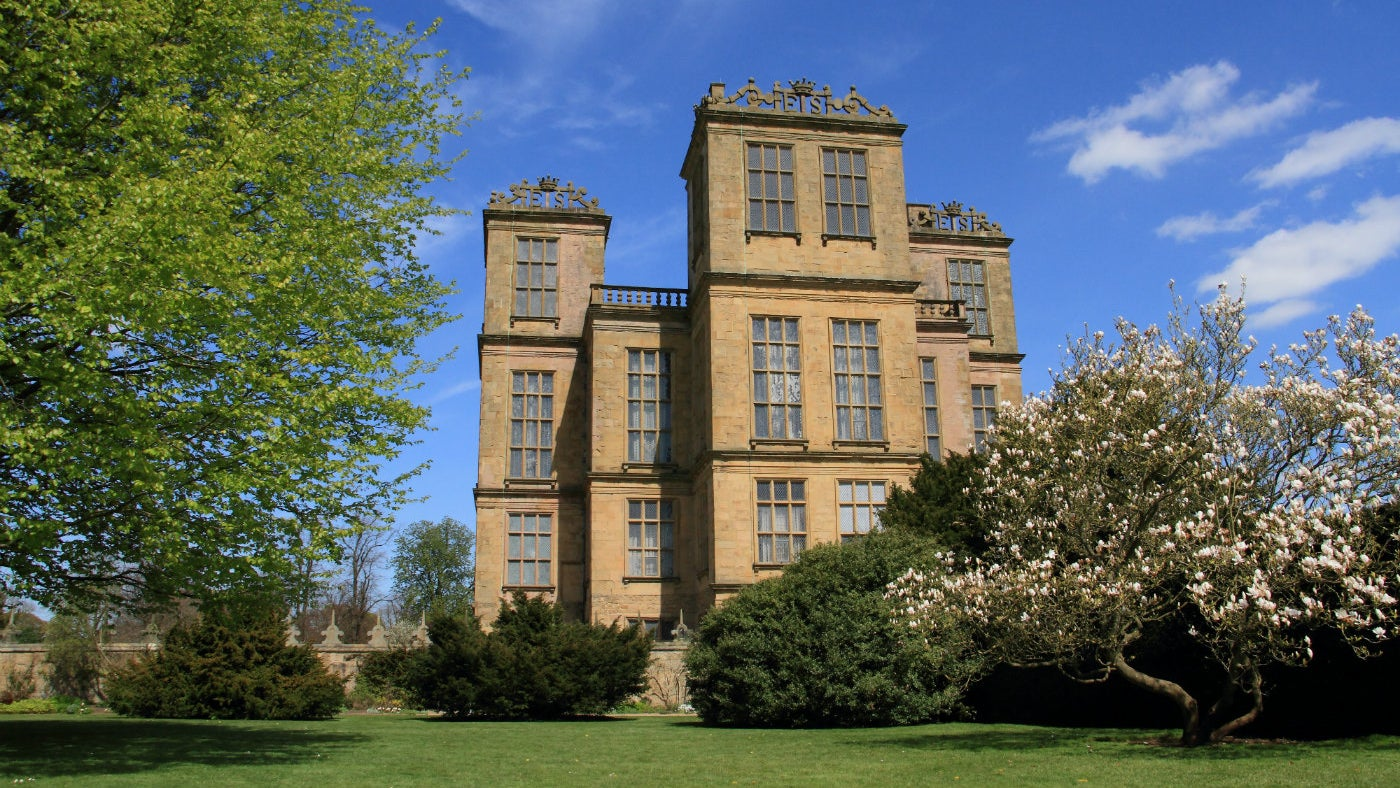 Hardwick Hall from the outside with spring blossom