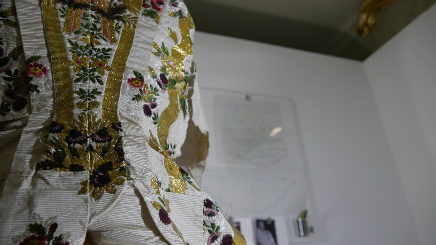 A close-up shot of the court mantua dress owned by Ann Bangham