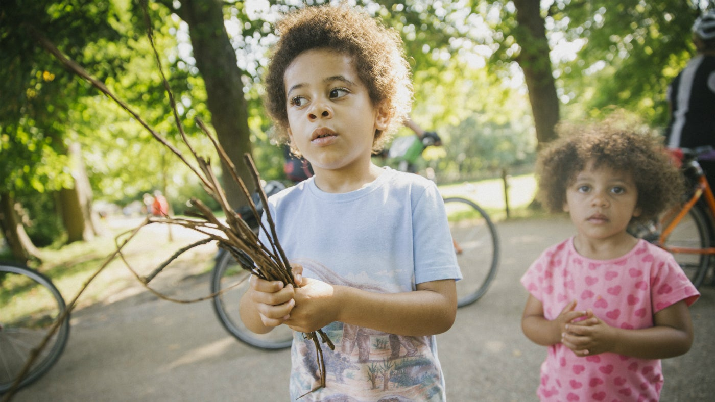 Children playing with sticks at Morden Hall Park