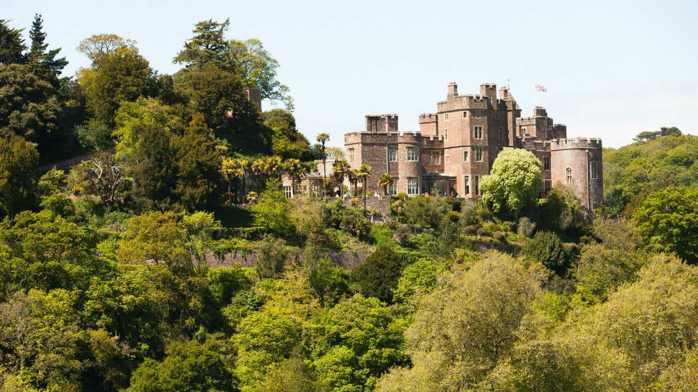 View of Dunster Castle showing its dominant position above the village of Dunster, Somerset