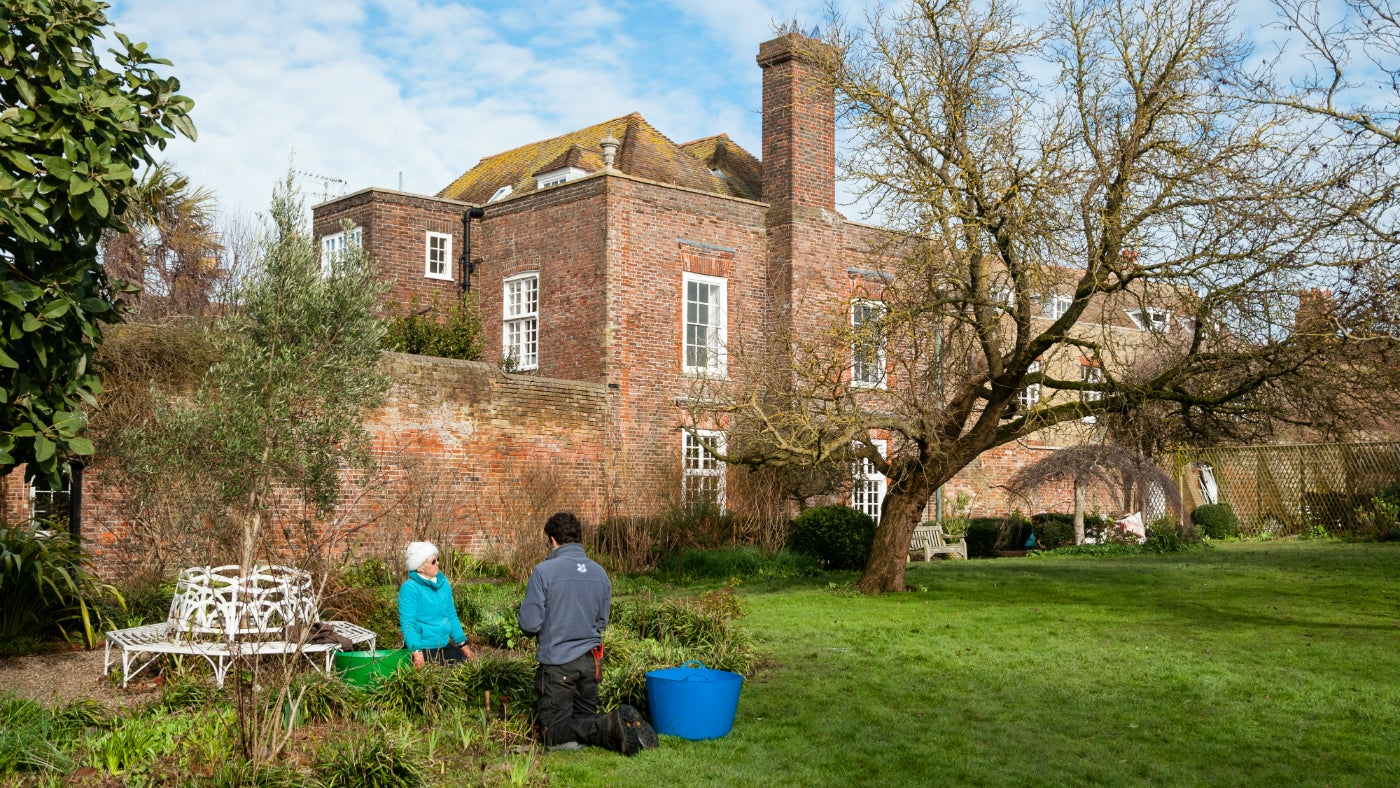 The gardeners working in the garden at Lamb House