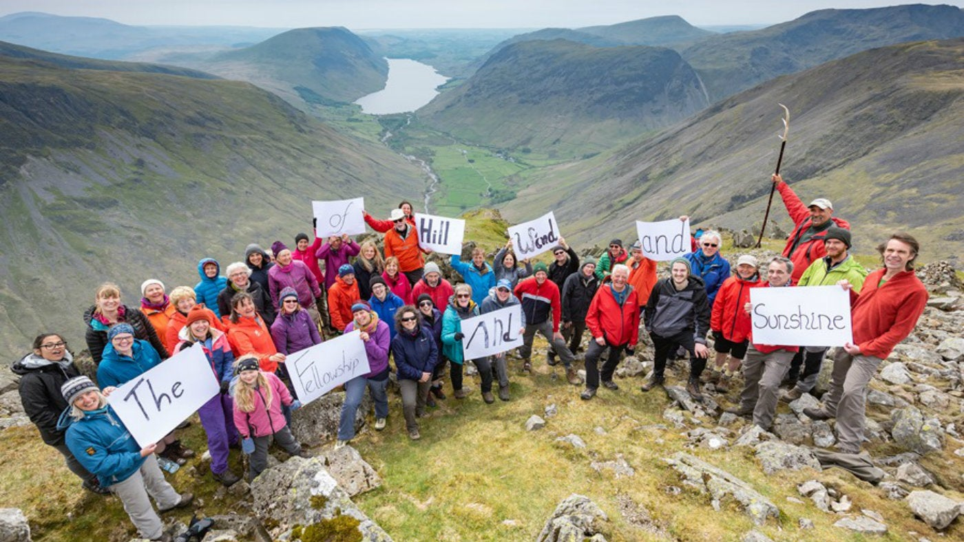people holding cards on a crag overlooking Wastwater