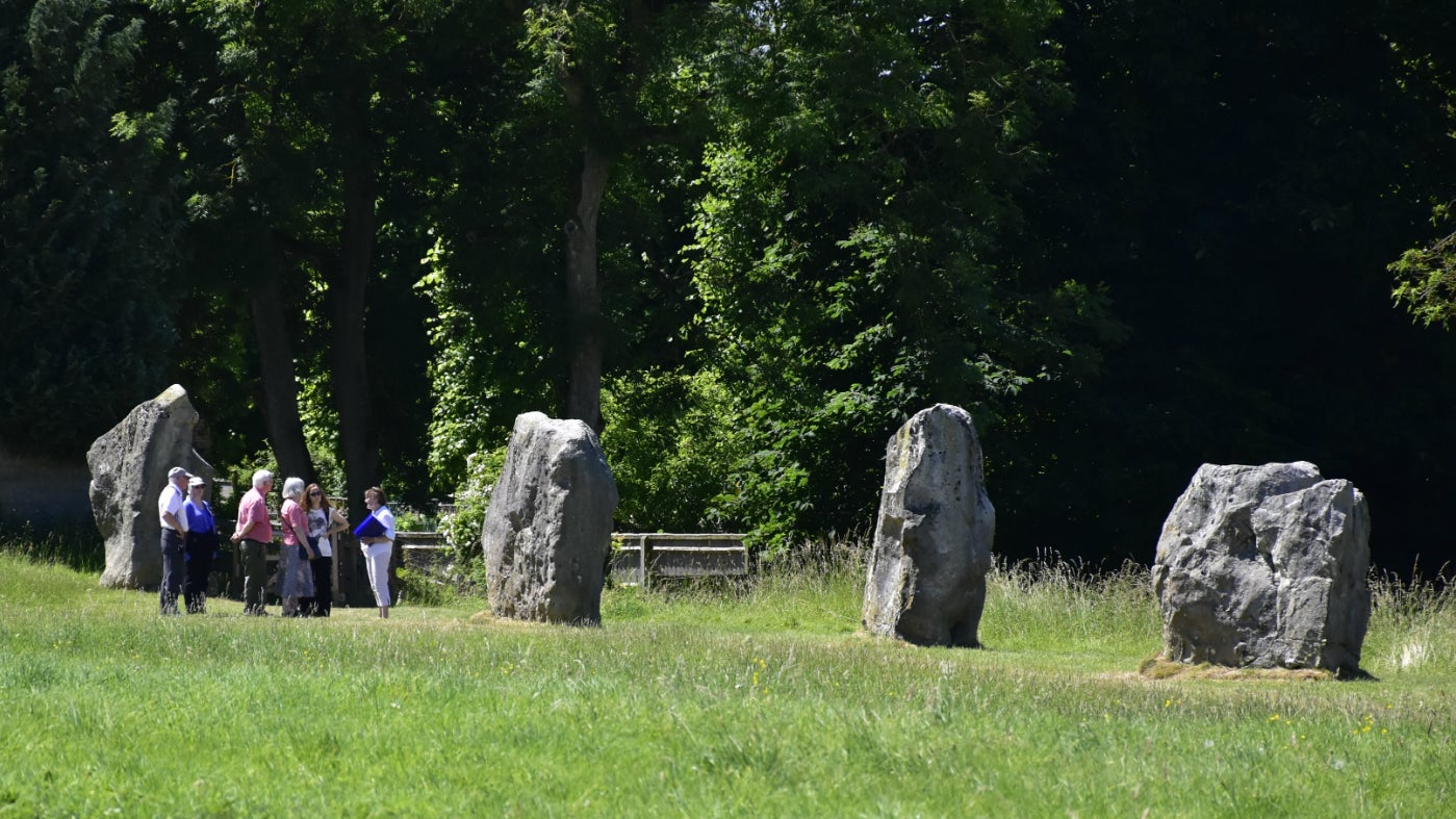 Group walking around Avebury