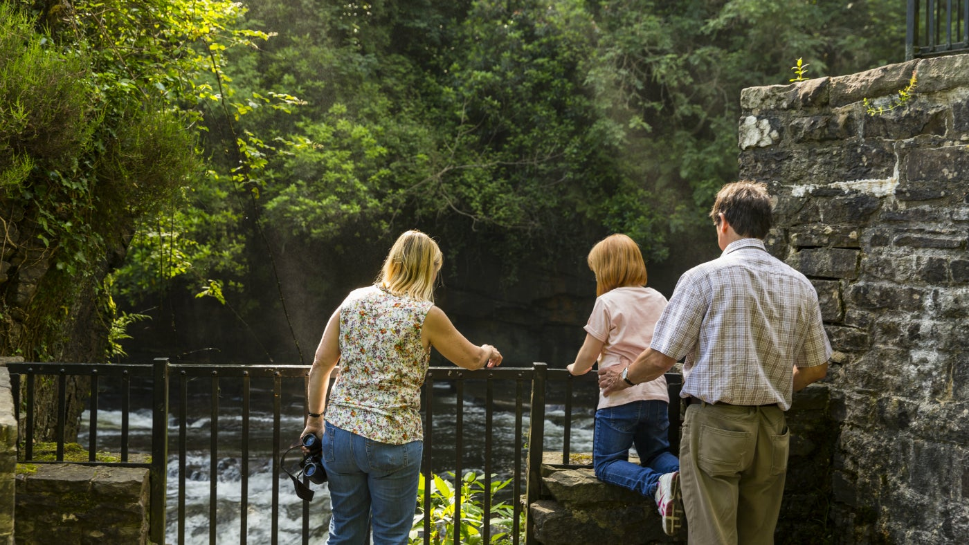 Aberdulais summer visitors by waterfall
