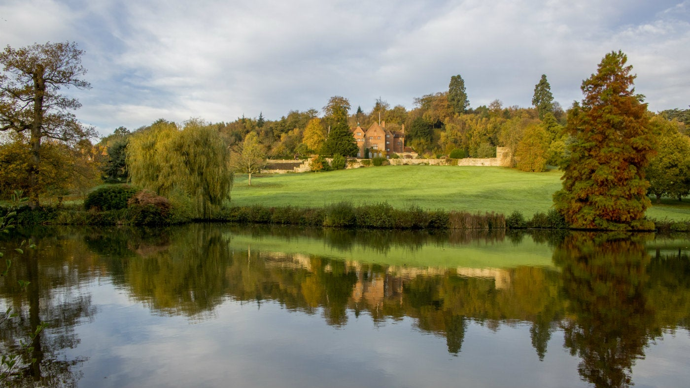 A lake view to the house in autumn at Chartwell, a National Trust in place