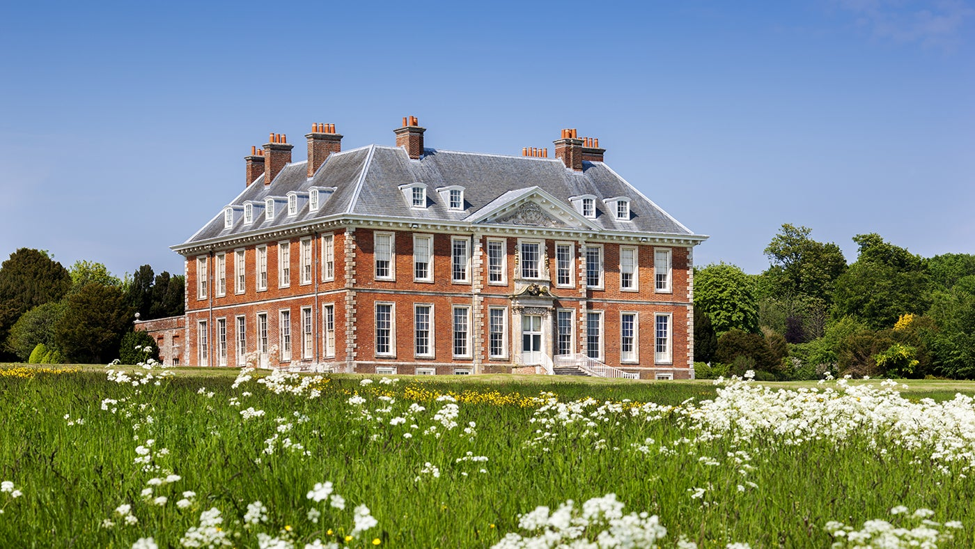 South front of the house from the meadow at Uppark House and Garden, West Sussex.