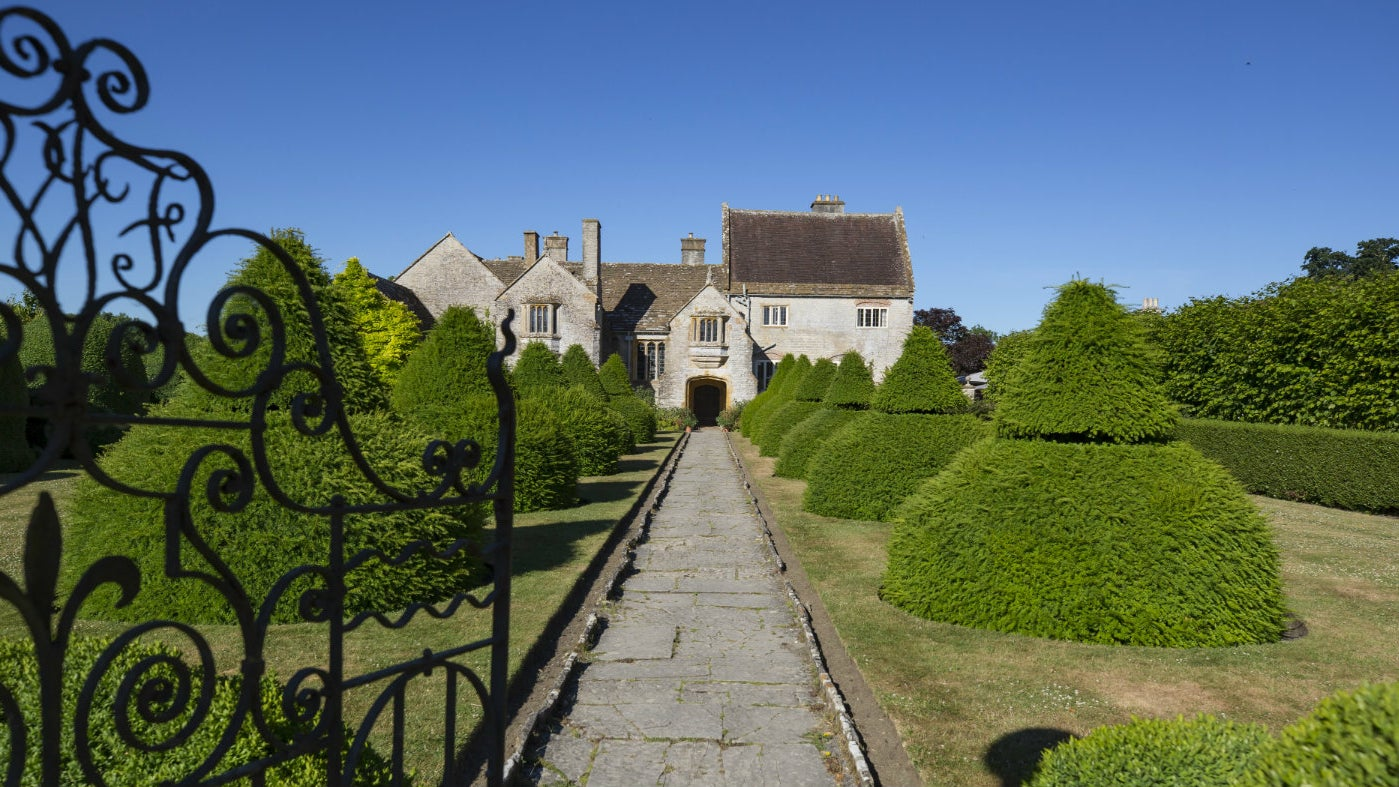 View of Lytes Cary Manor through the Apostle Garden