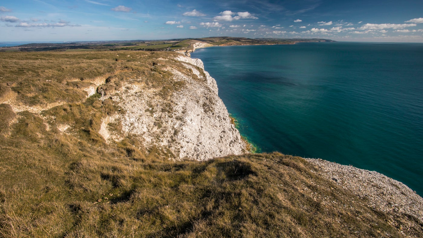 Looking over the sea-blue of Freshwater Bay from the top of the chalk-white cliffs of Tennyson Down