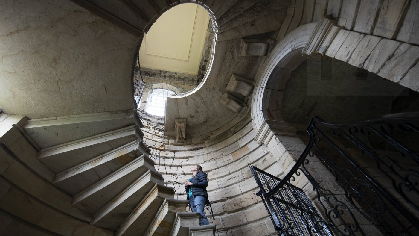 Tina Wiffen stood on a spiral staircase searching for bats at Seaton Delaval Hall