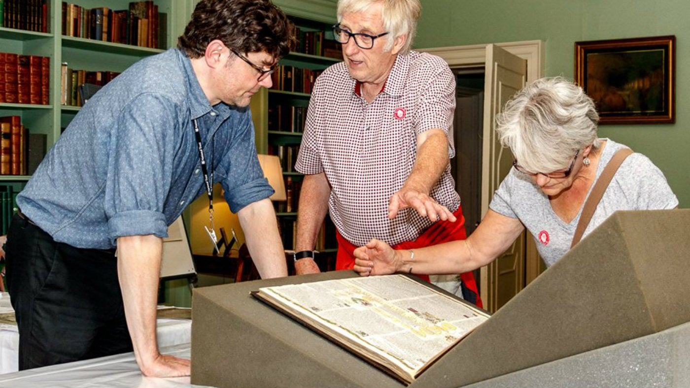 Librarian John Gandy talks to visitors about the book collection