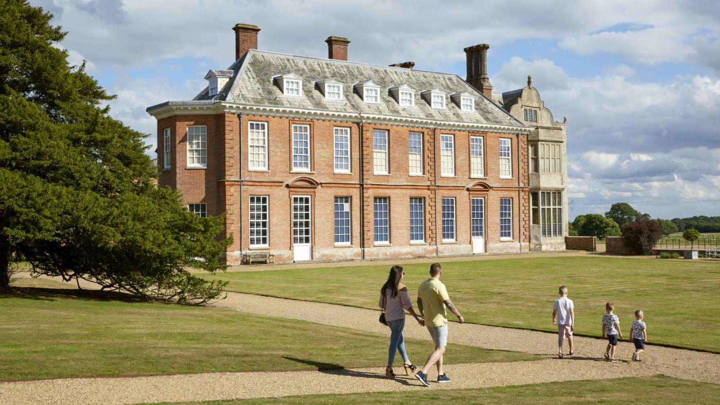 A family walking in the ground of Felbrigg Hall, Norfolk