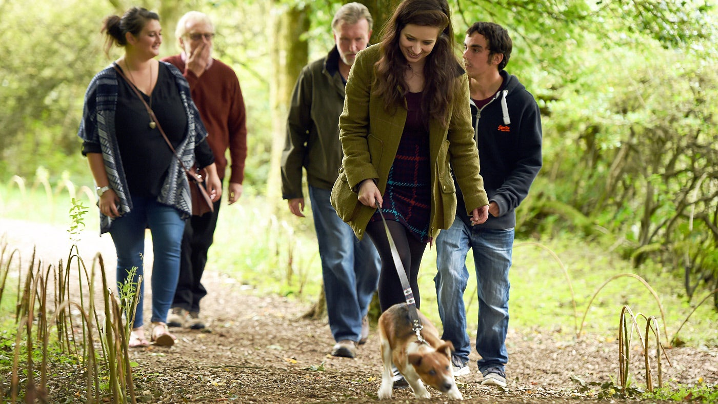 visitors walking dog on the estate