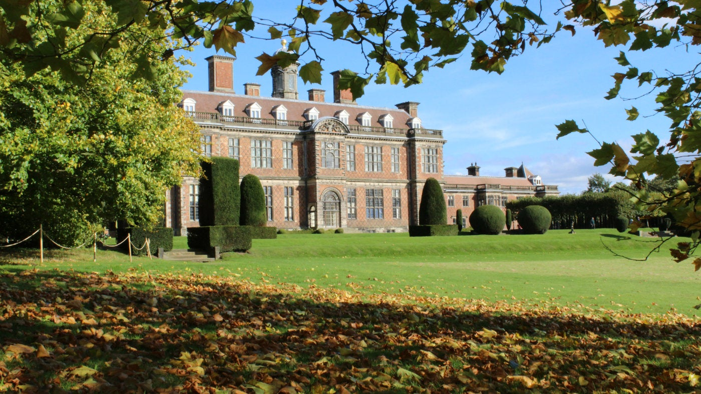 Sudbury Hall through the trees in Autumn