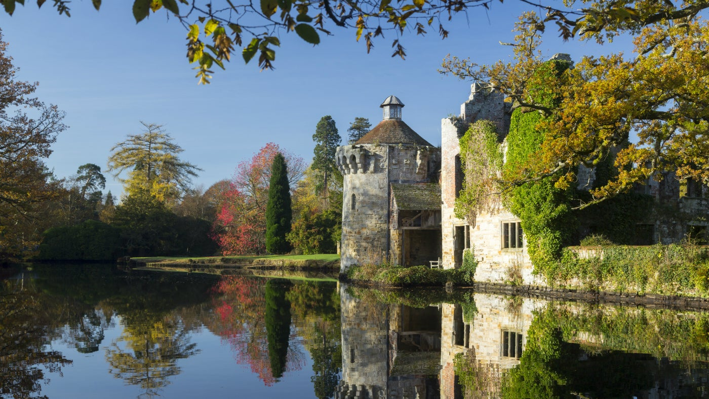 Autumn reflections over the moat at Scotney Castle