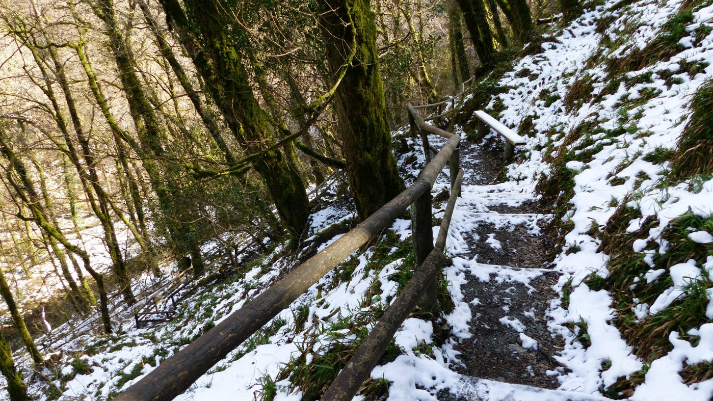 The steps to Whitelady Waterfall with a covering of snow on the ground around