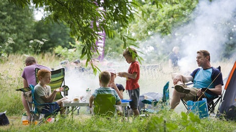 Families relax at a National Trust Big Camp