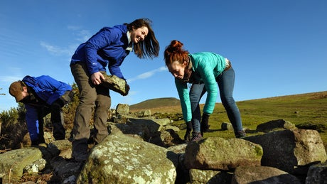 Volunteers repairing dry stone wall in Wales