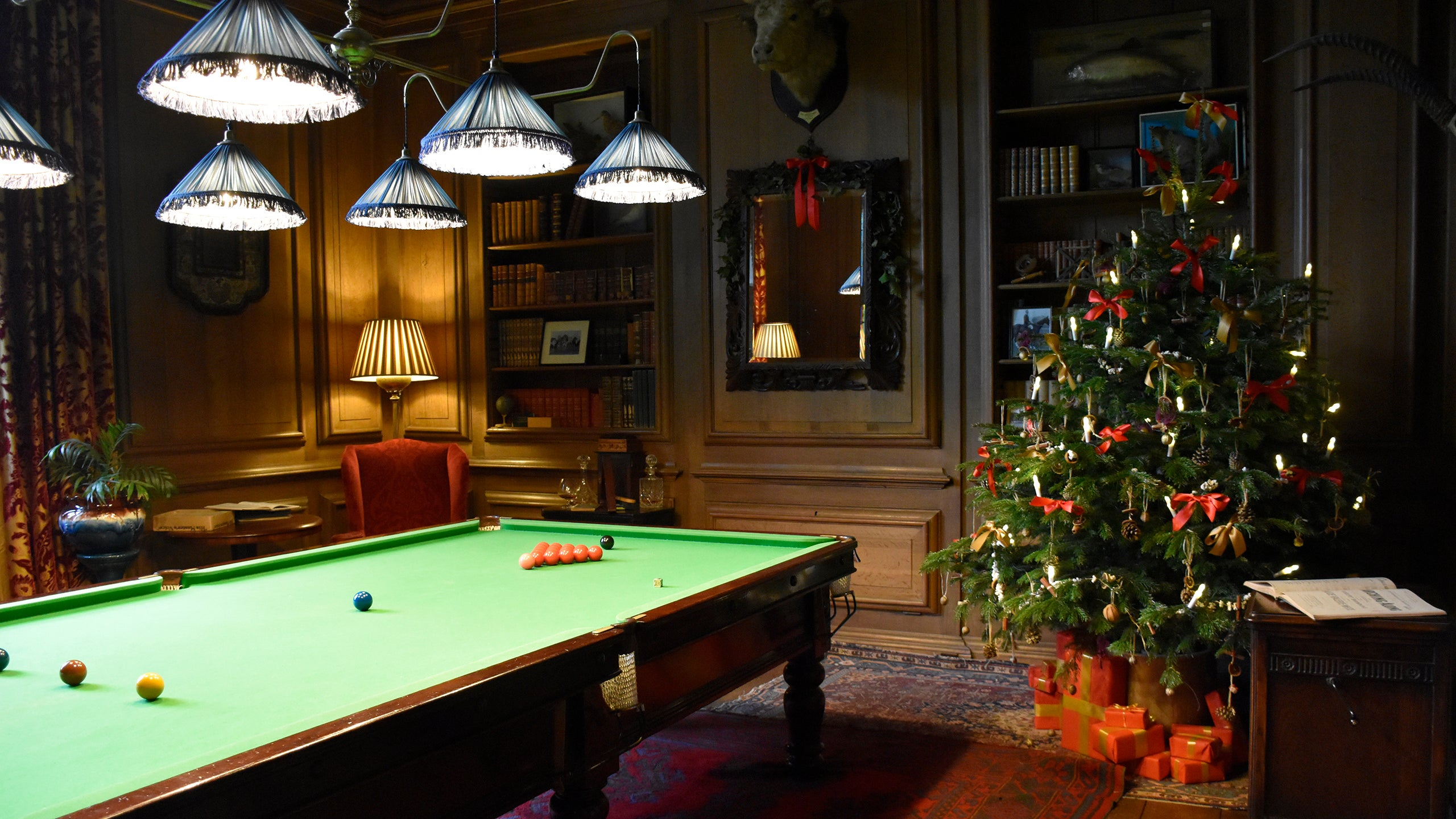 The billiard room dressed for Christmas at Avebury Manor, Wiltshire