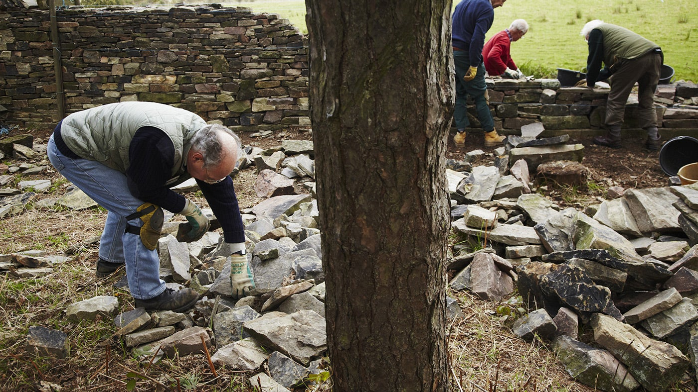 Volunteers repairing dry stone wall