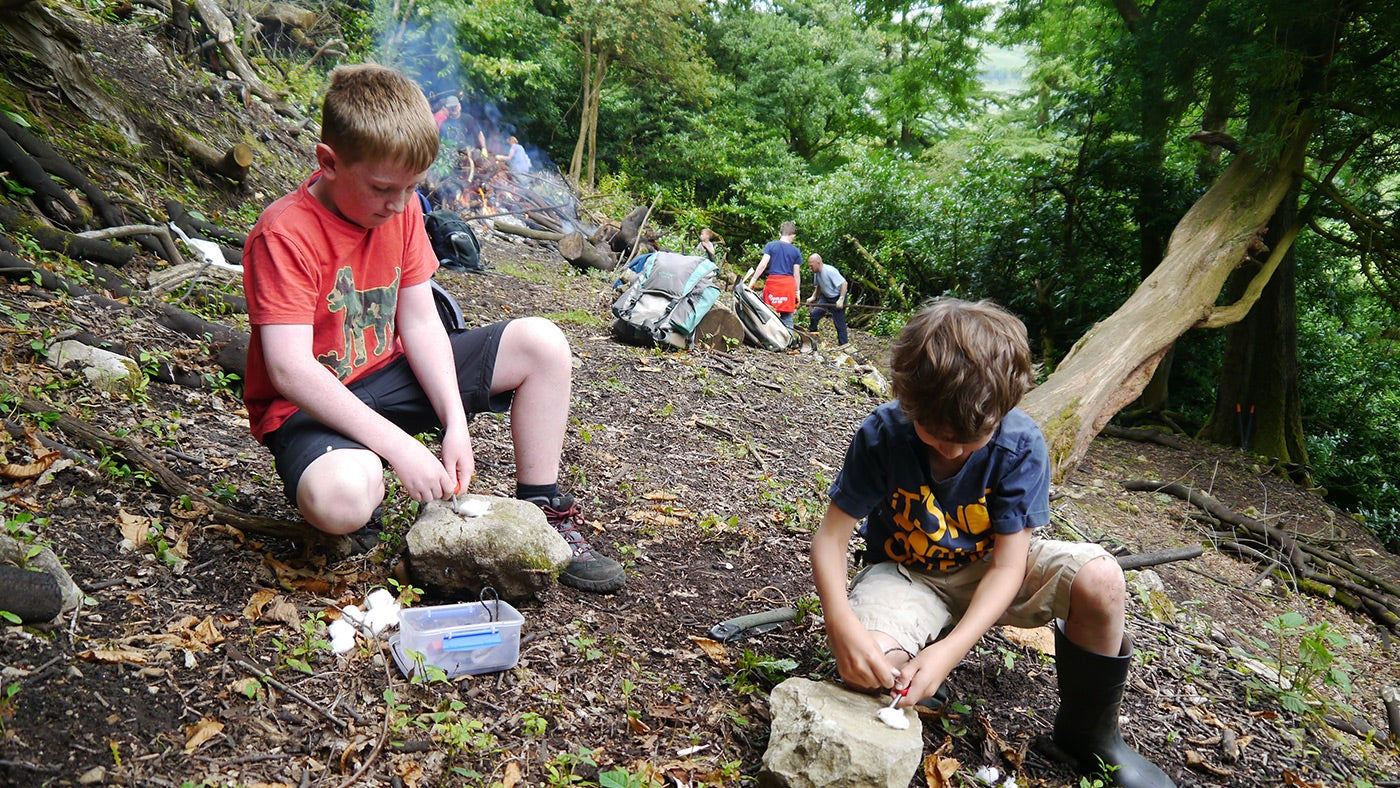 Families learning about woodland skills on a working holiday at Upper Wharfedale