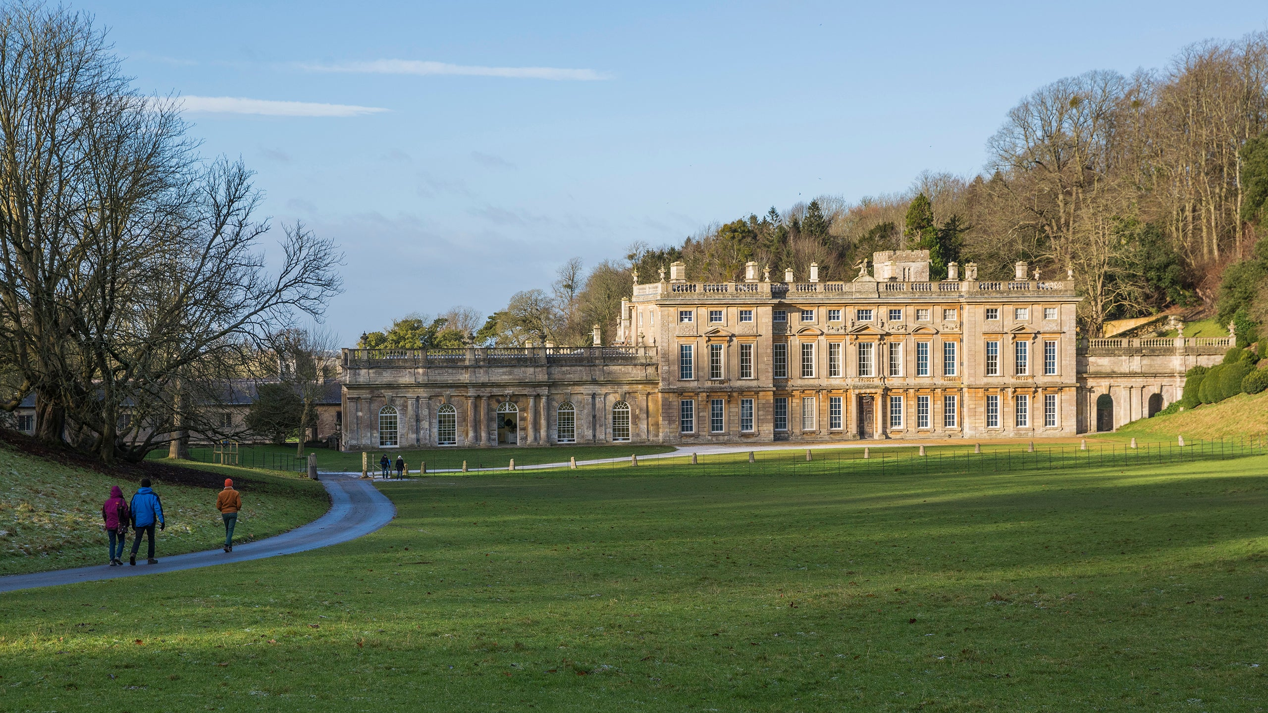 Visitors walking towards the house in winter at Dyrham Park, Gloucestershire