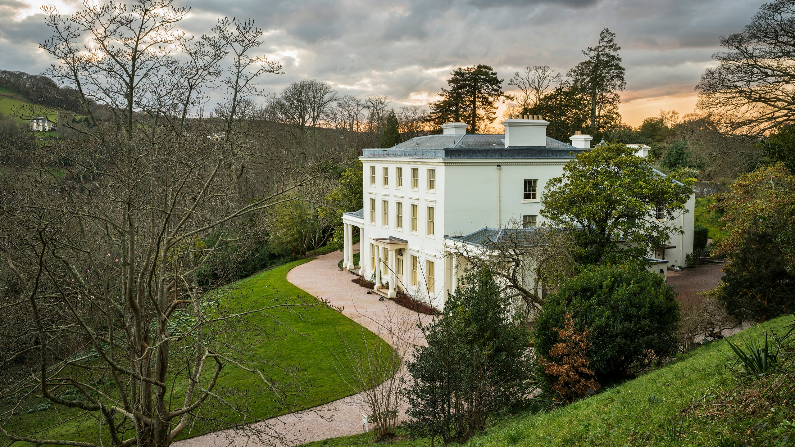 View of the House with the River Dart below at Greenway Devon