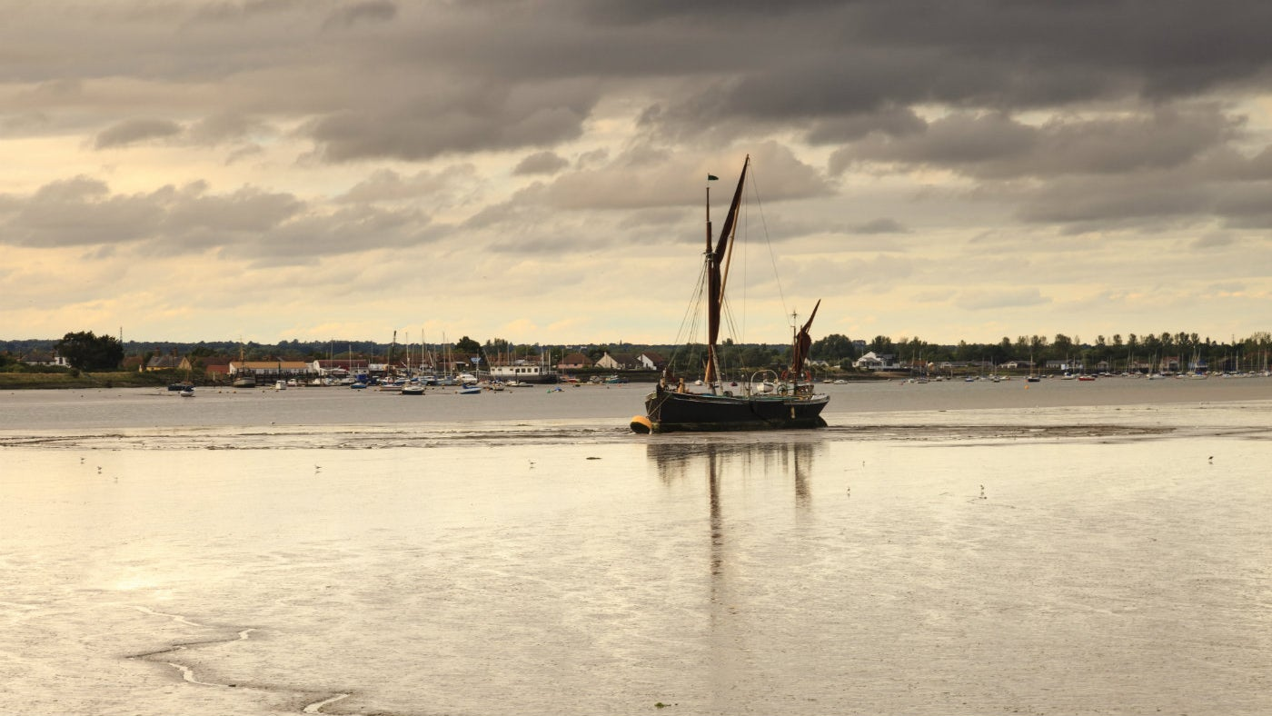 A barge sails down the Blackwater Estuary, as seen from Northey Island