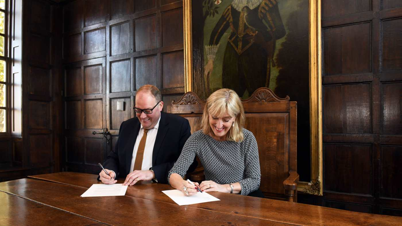 Darren Henley, Chief Executive of Arts Council England and Hilary McGrady, Director General of the National Trust signing the agreement at Sutton House in Hackney