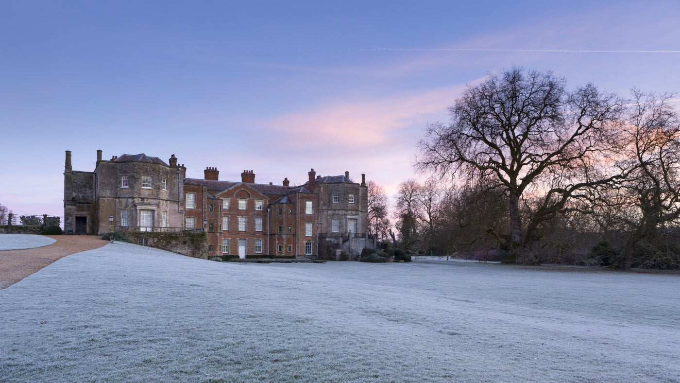 Looking across a frosty lawn to Mottisfont house and the great plane tree