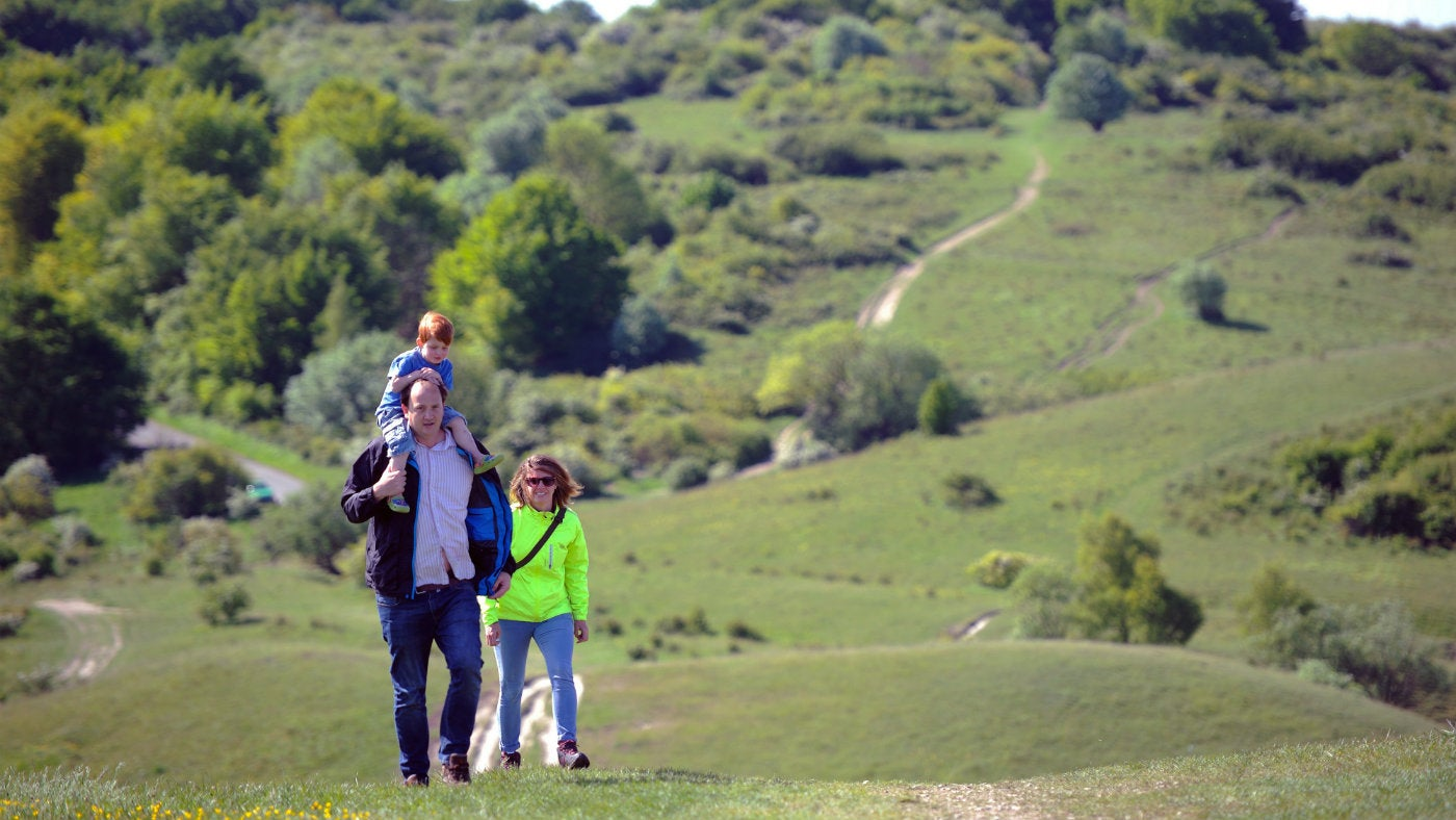 Family walking on Ivinghoe Beacon at Ashridge, Herts