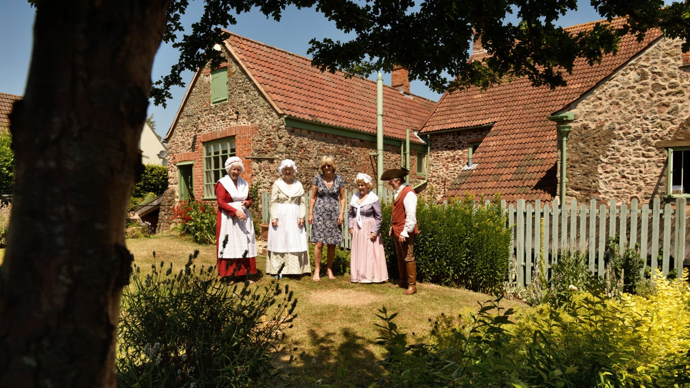 Costumed volunteers in the garden at Coleridge Cottage