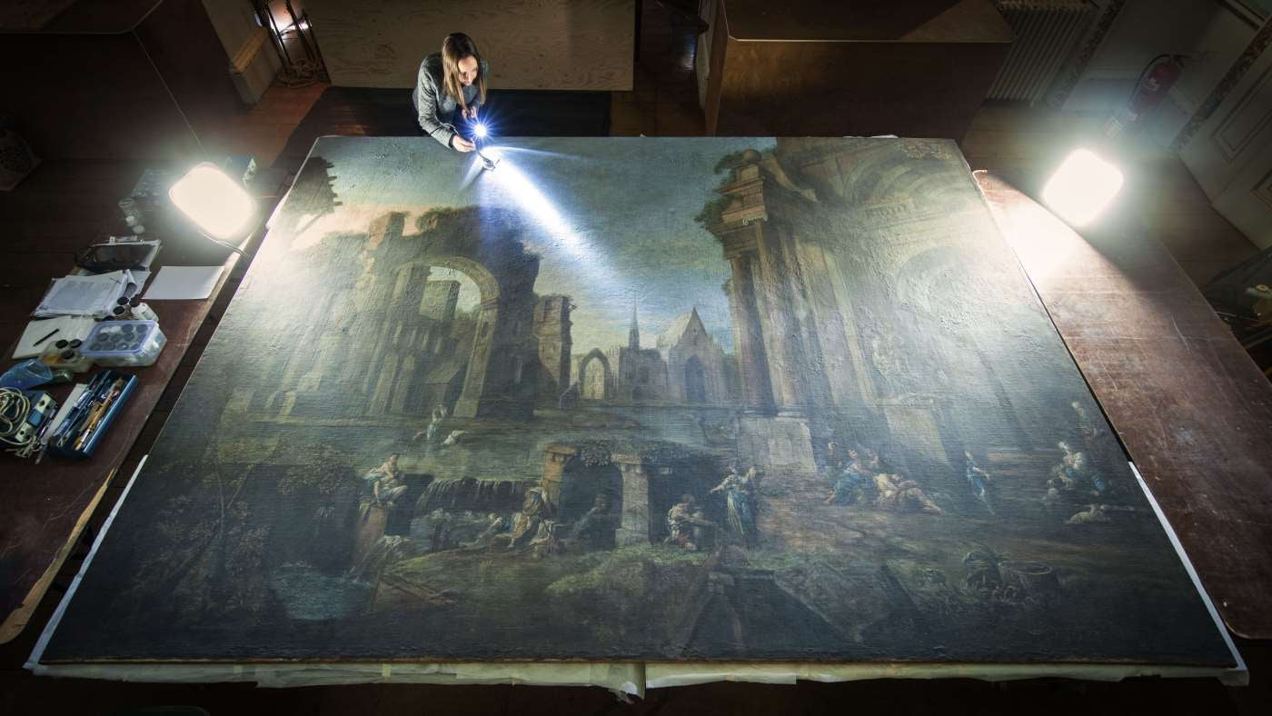 Conservator Lucy Critchlow working on the conservation of one of the Trust's largest paintings at Shugborough in Staffordshire.