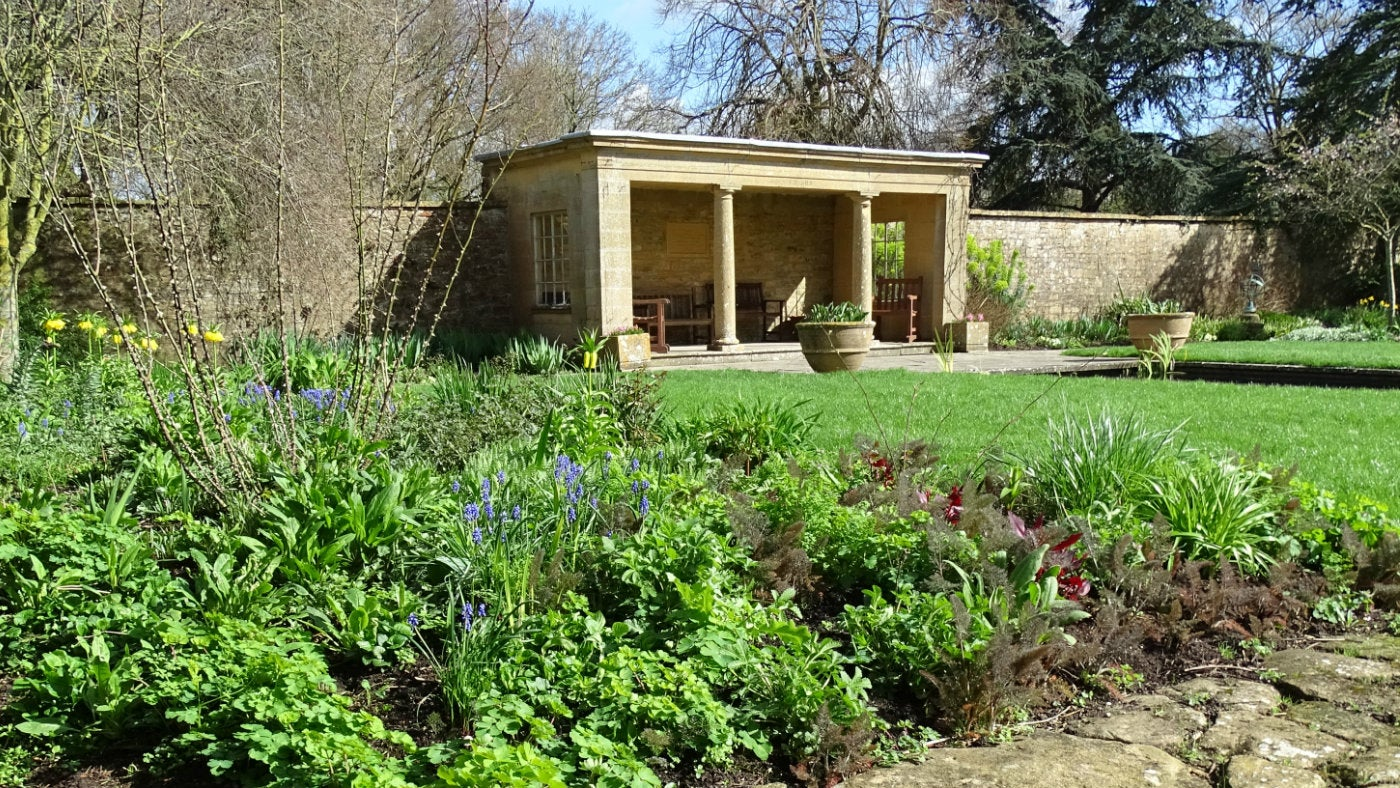 The pool garden at Tintinhull in the spring sunshine
