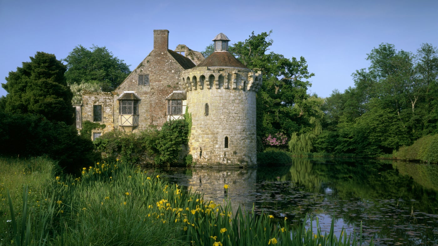 The circular 14th century Ashburnham Tower in spring at Scotney Castle