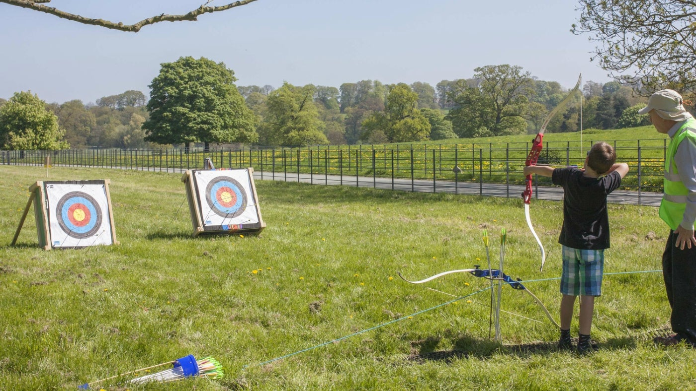 Child having a go at Archery