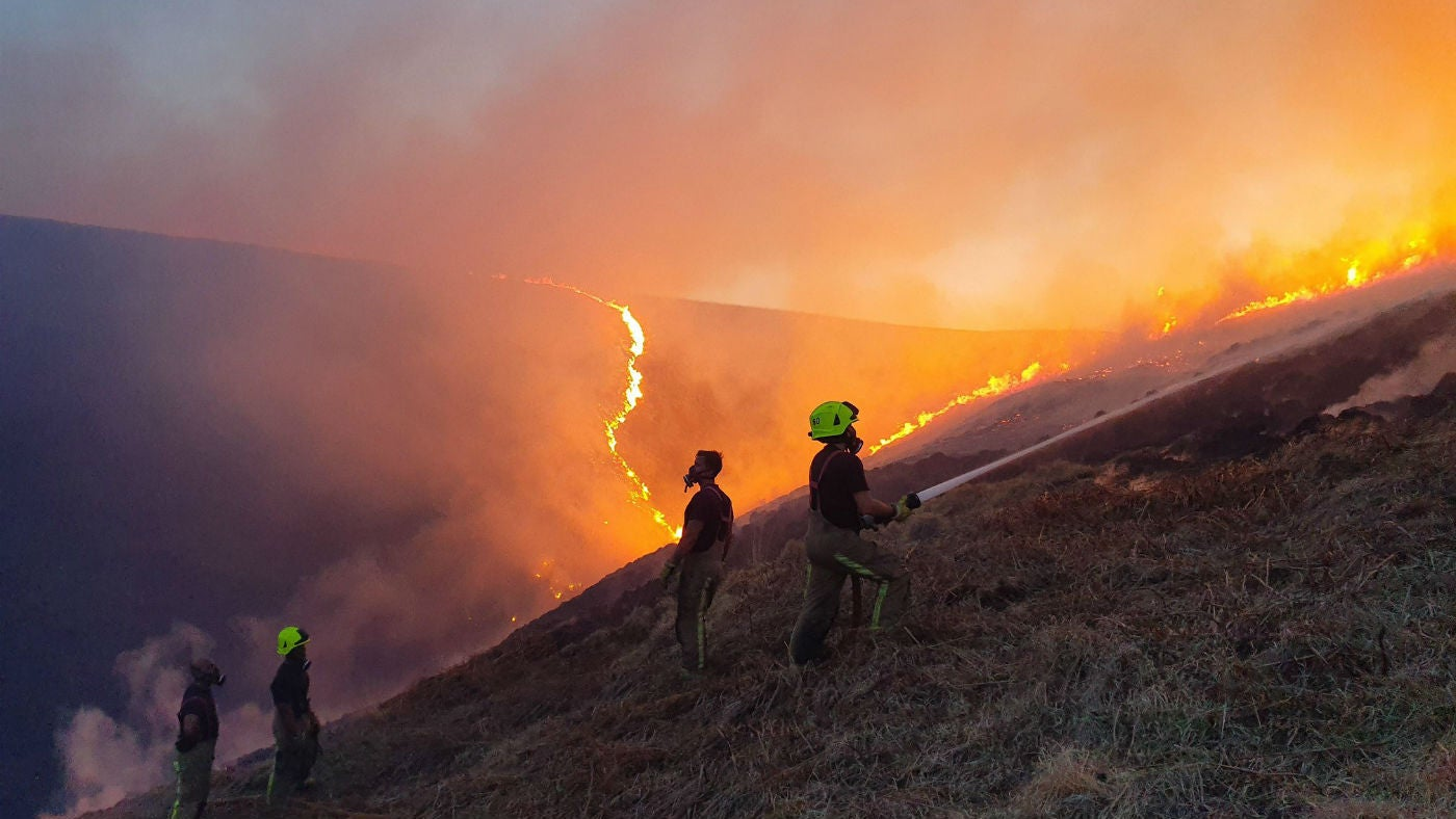 Firefighters tackle the blaze on Marsden Moor