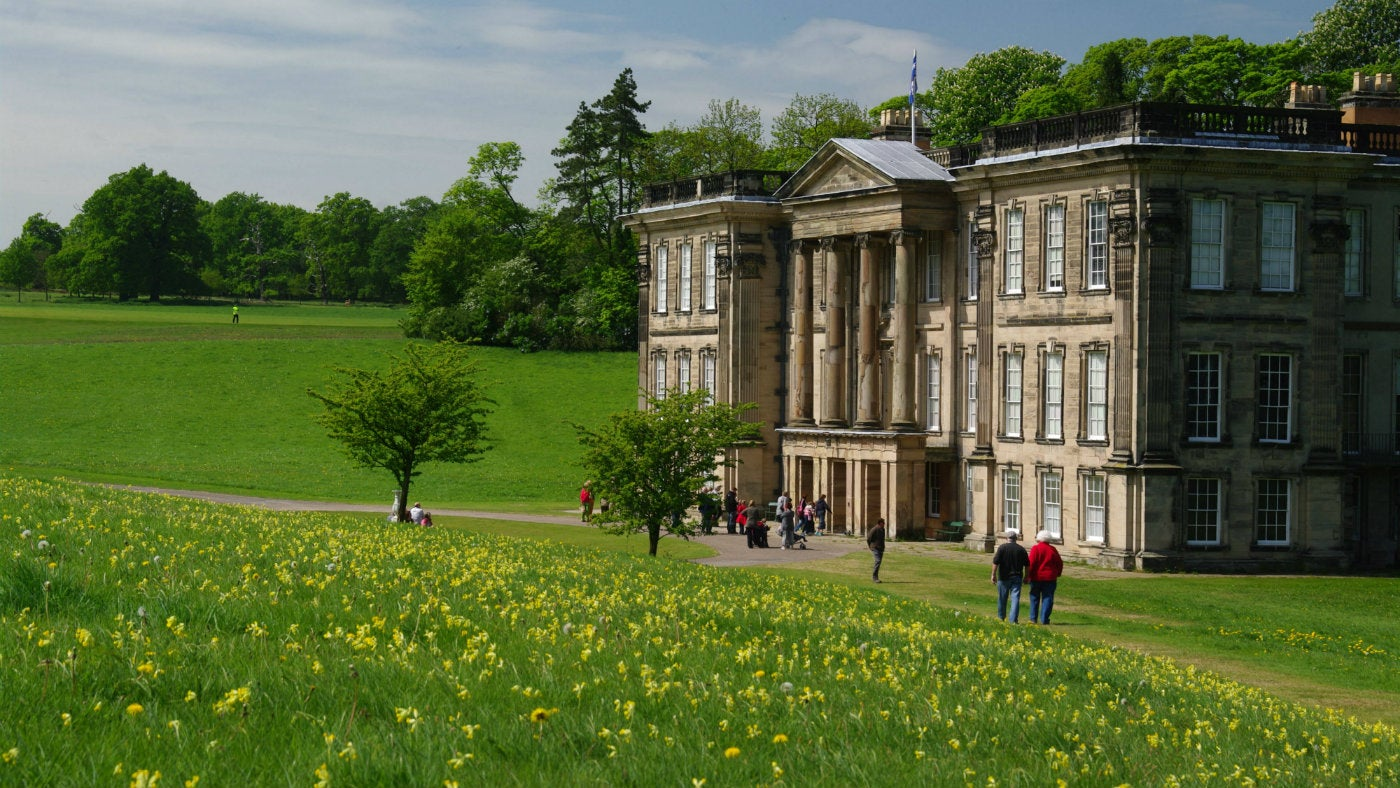 Calke Abbey house with visitors in front
