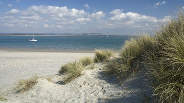 The beautiful white sands of East Head offer a perfect place to relax