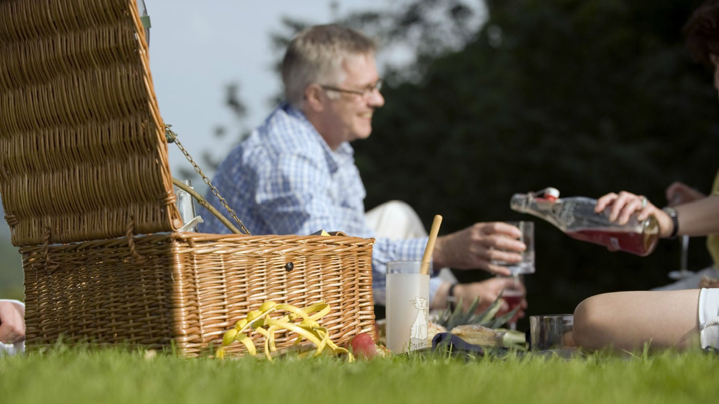 Smiling older man with picnic basket