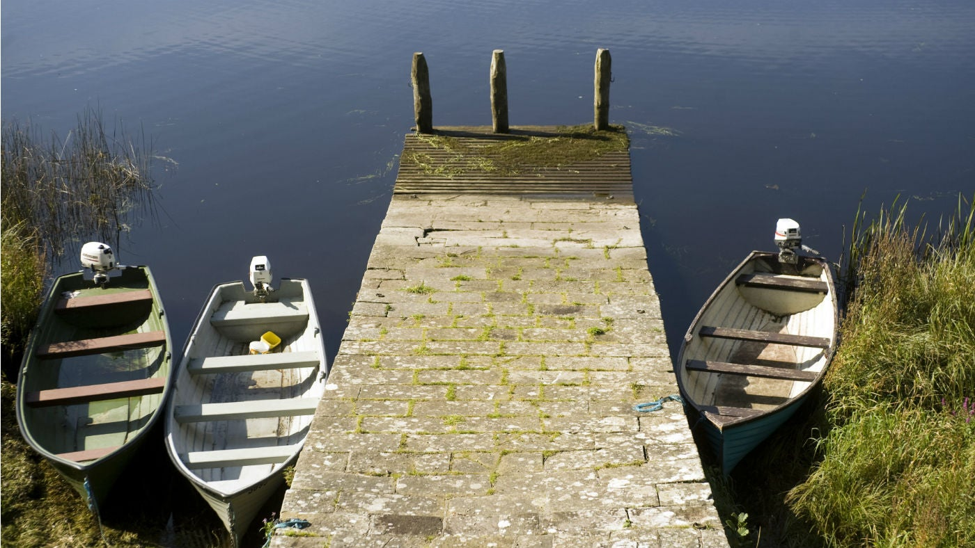 Boats moored at the slipway of the boathouse at Crom
