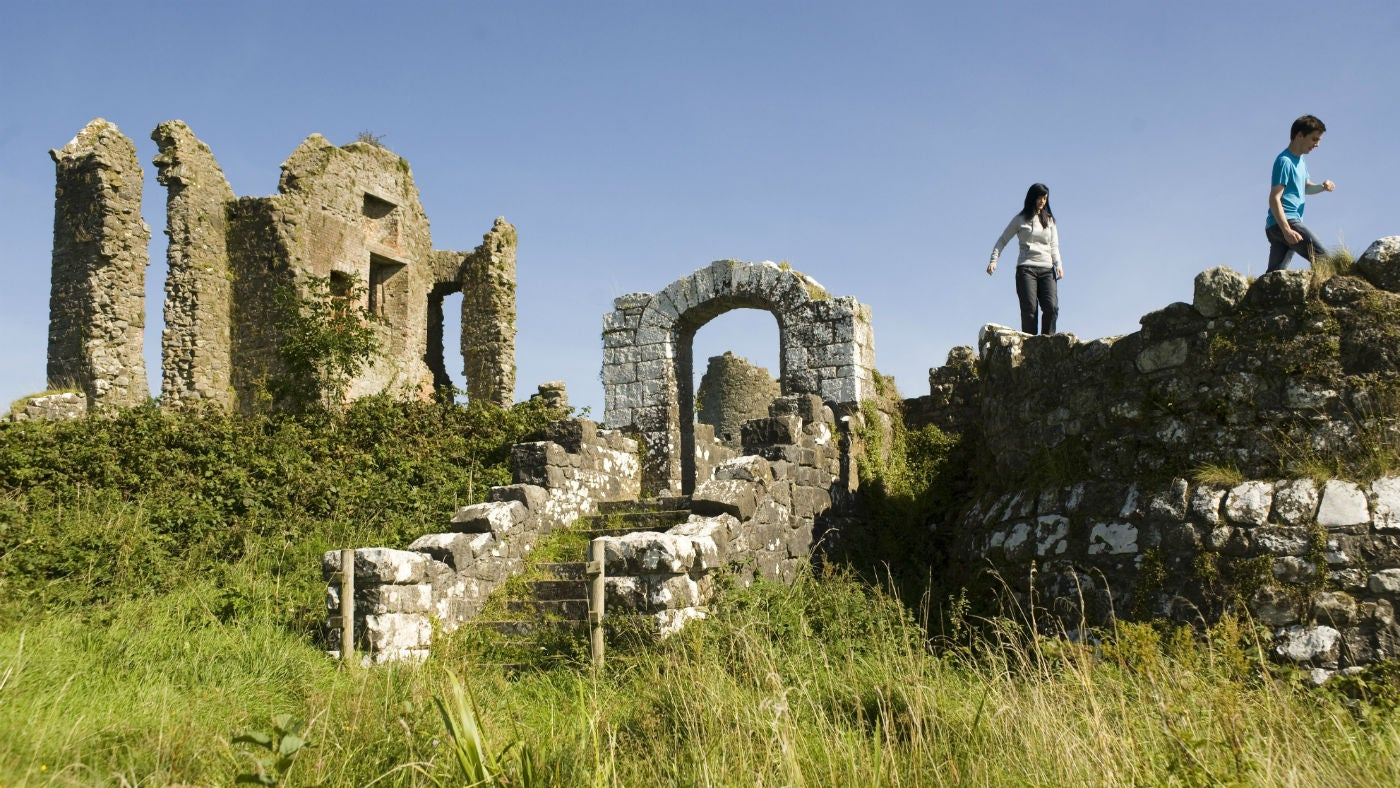 Visitors exploring the ruins of the old tower-house at Crom
