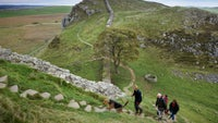 People walking at Hadrian's Wall, Northumberland.
