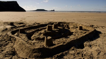 Sandcastle on the beach of Rhossili Bay, Gower